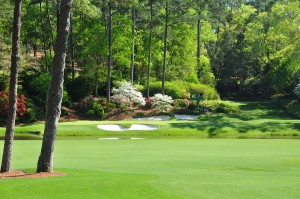 the 12th green at the Masters viewed from the 13th fairway